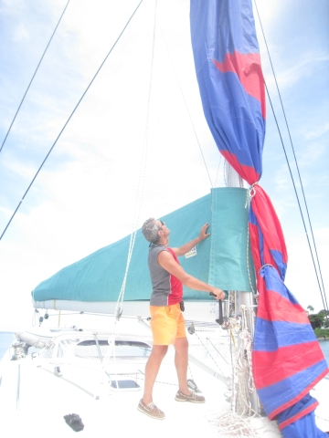 Noel hoisting Jerry up the mast to untangle the spinnaker