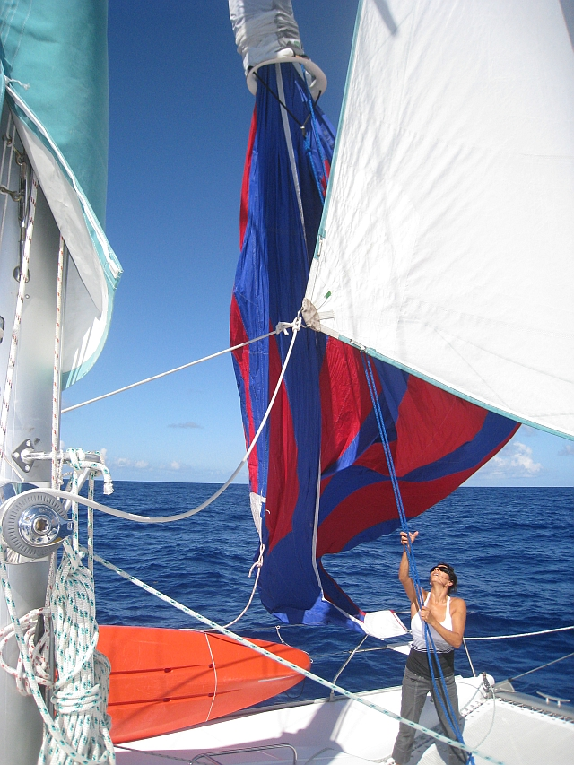 Ceu hoisting the sock so as to release the spinnaker