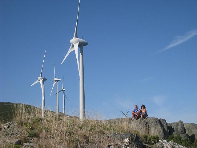 Noel and Ceu sitting below huge wind generator