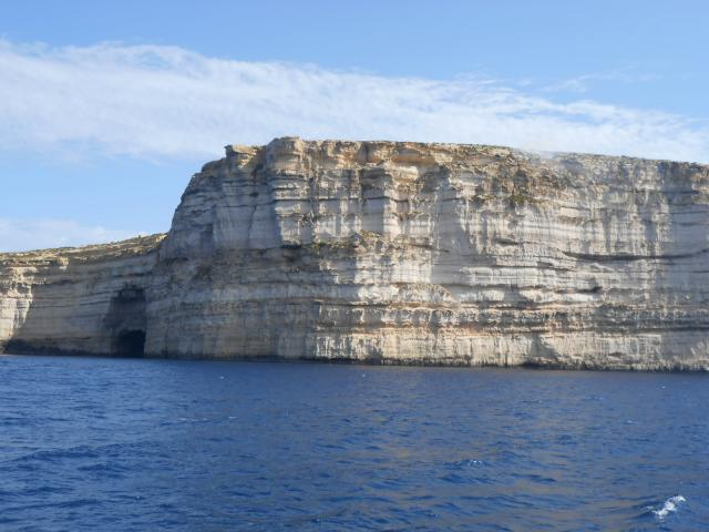 the beautiful coastline of Gozo with many cliffs and caves
