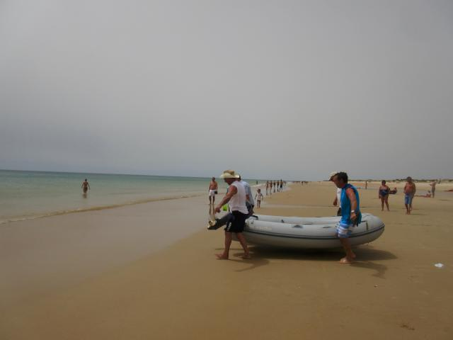Bringing the dinghy up above the high tide line at Manta Rota, with the help of Uncle Tony and Virgilio