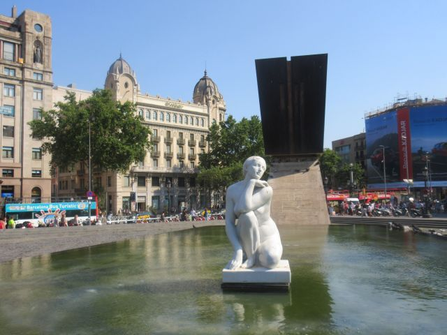 Placa de Catalunya. From here marks the beginning of La Rambla, which gently slopes all the way down to sea. This boulevard is showcase of colorful universal vendors and stalls, lined with Museums, Opera house,Theatre and many unexpected attractions.
