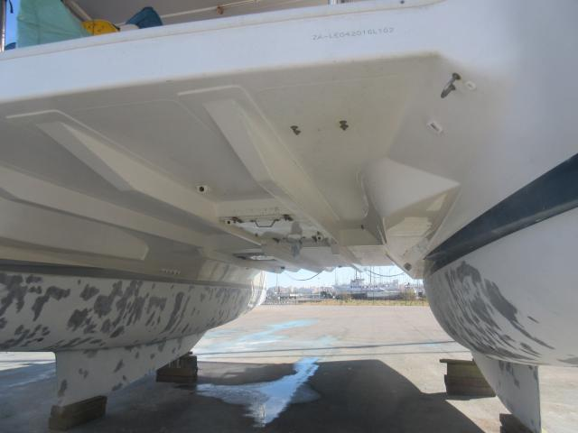 The grey blotches are where we filled in holes with epoxy filler. We also skimmed over the whole hull to flll in the rough pitting.