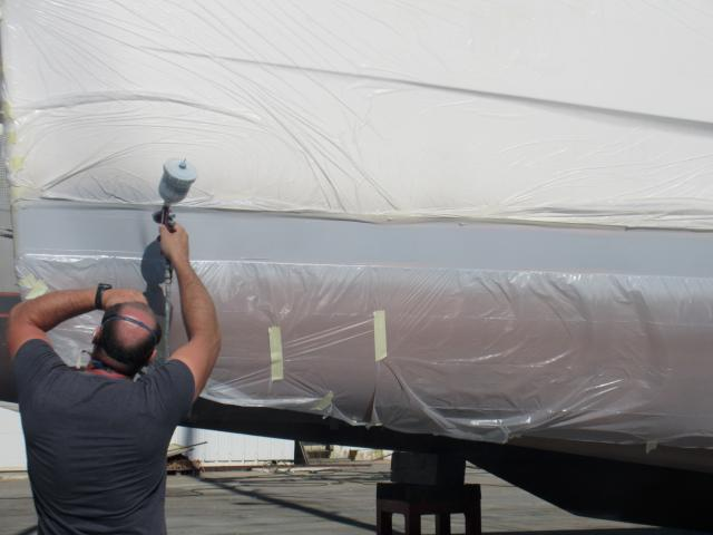 Michel's working spraying the stripes. The last job on the list!