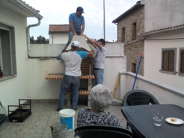 Mum supervising the construction of a new barbeque at Ceu's mom's house in Casegas