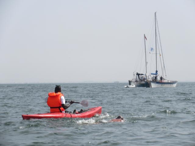 Ben Hooper and his kayaker as he swims the first mile of this trans-Atlantic attempt
